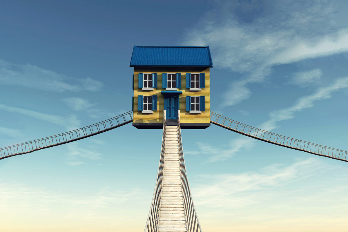 Three bridges to a home are displayed in this photo illustration meant to represent a path to homeownership.