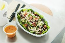 Chipotle salad bowl on table