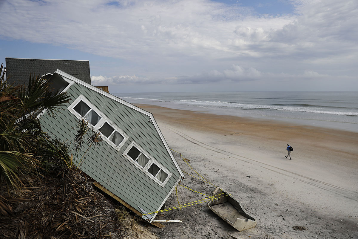 A house rests on the beach after collapsing off a cliff from Hurricane Irma in Vilano Beach, Florida, Friday, Sept. 15, 2017.