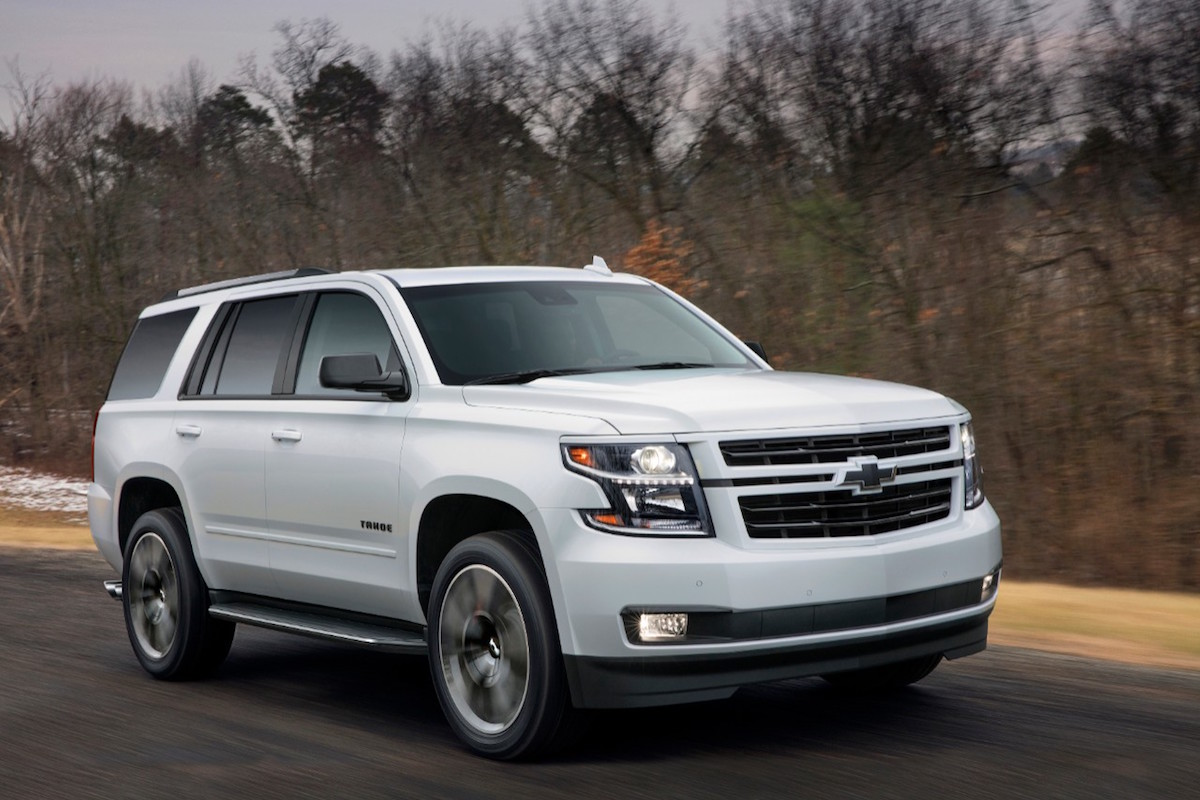 white Chevrolet Tahoe driving down the road