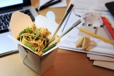 Chinese food box on the office desk.