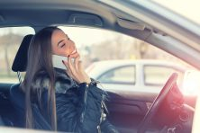 Female driver talking on phone