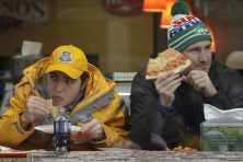 Super Bowl XLVIII volunteer Andrew Esoldi, left, of Englewood Clifs, N.J., and Peter Clark, a tourist from Australia, eat pizza on Super Bowl Boulevard on Jan. 29, 2014, in New York