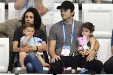 Mila Kunis, left, and her husband Ashton Kutcher are seen with their children at the 17th FINA Swimming World Championships in Budapest, Hungary on Monday, July 17, 2017. Tibor Illyes/MTI via AP