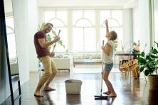 man and his daughter mopping the floors in their home as part of their spring cleaning