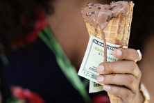 Woman enjoys gelato while making a run to the ATM.