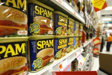 Cans of Spam on a store shelf