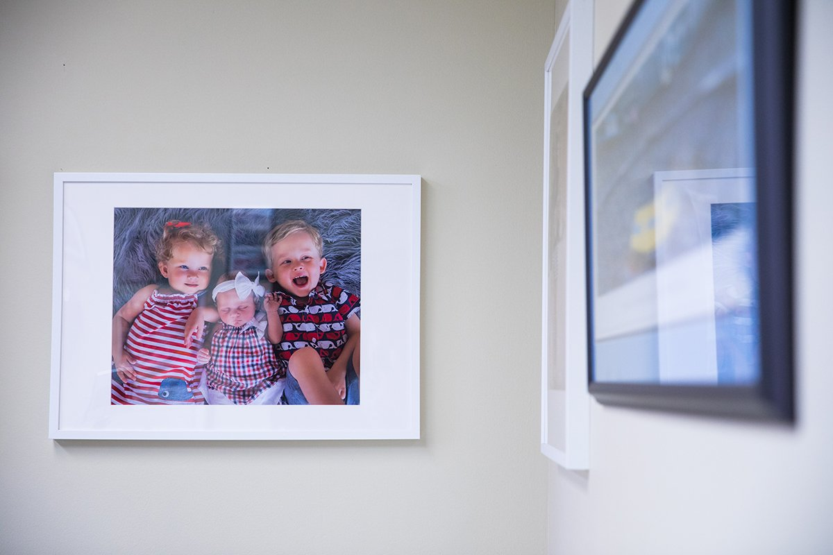 A family photograph hangs on an office wall