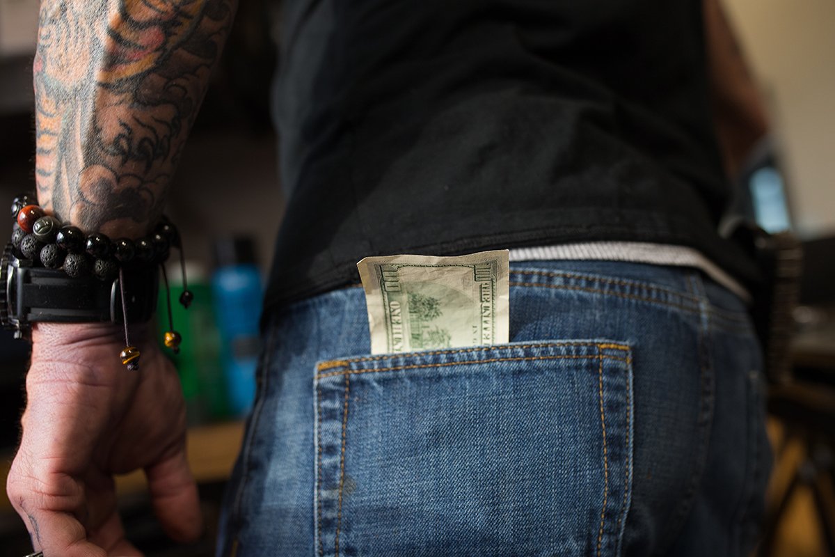A tip is placed in David Hensley's back pocket in Tampa, Fla