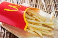 A box of Mc Donalds French Fries on a wooden tray on September 19, 2015.