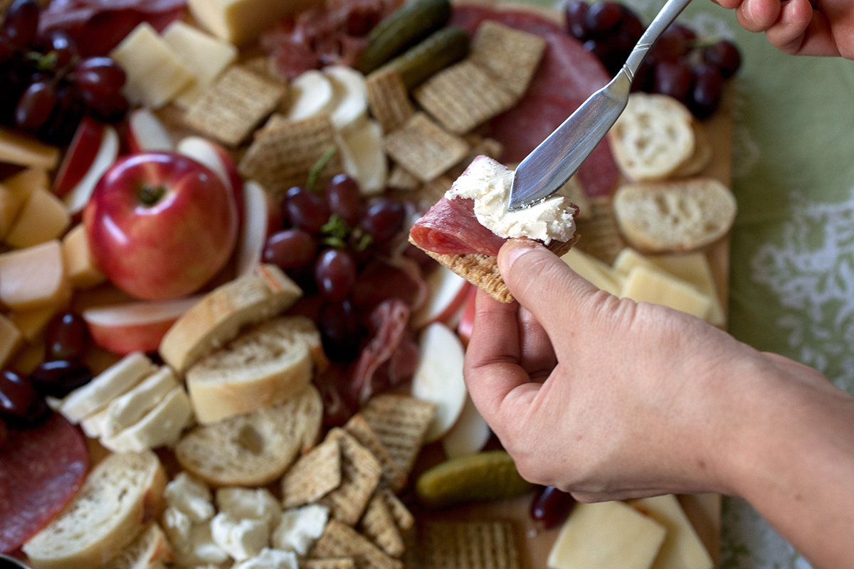 Penny Hoarder writer Stephanie Bolling built a charcuterie and cheese board with ingredients from Aldi in St. Petersburg, Fla., on October 23, 2016.