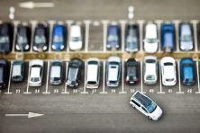 Cars on parking place from above.