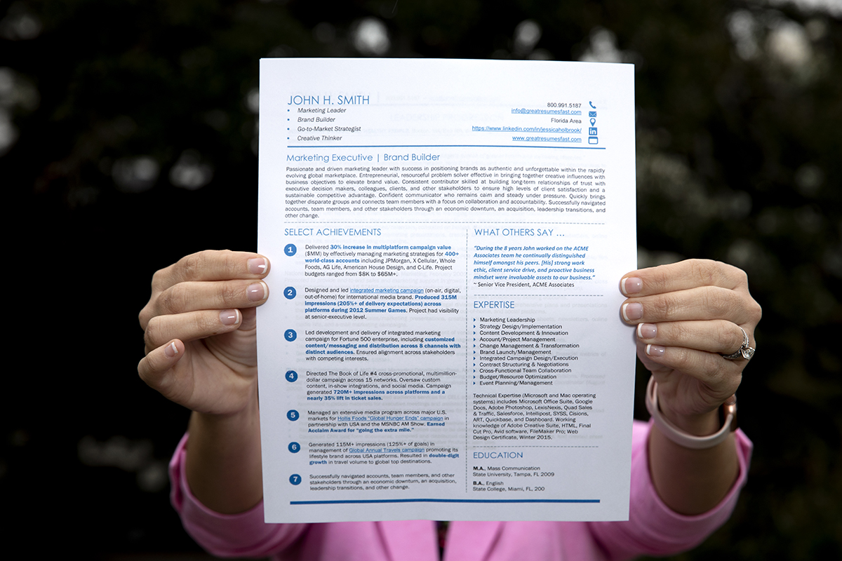 A woman shows what a good resume should look like.