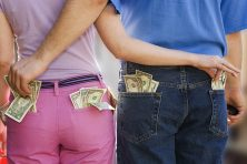 A man and woman sneak money out of each other's back pockets.
