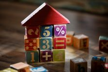 Children's building blocks are used to build a house.