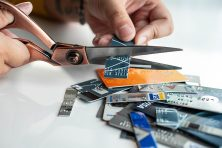A woman cutting up credit cards