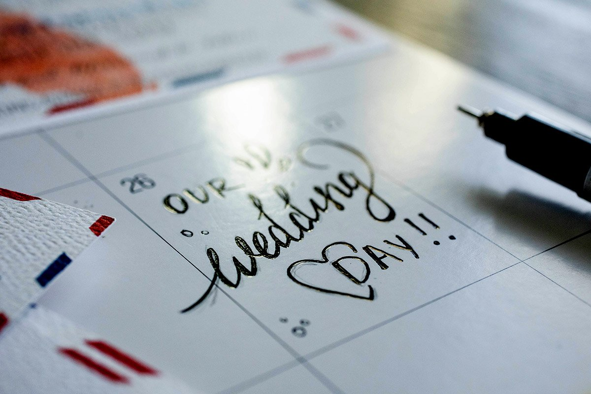 A wedding day is noted on a calendar.