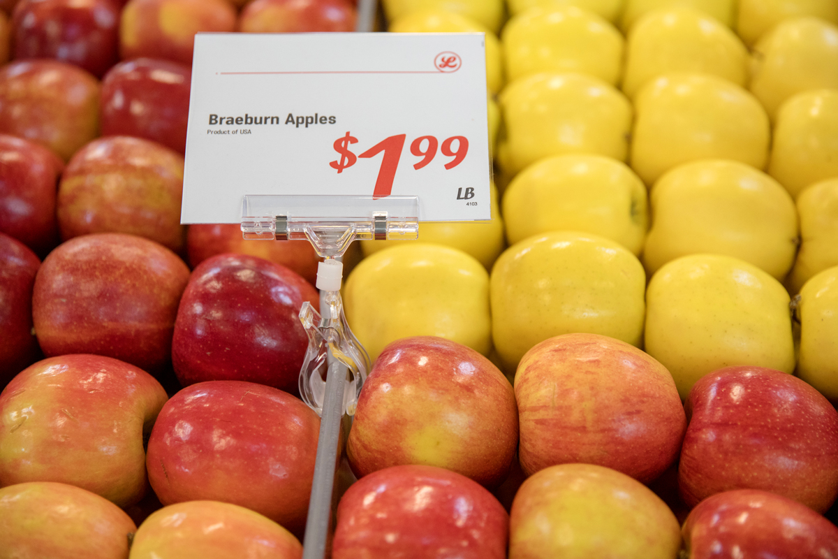 Apples are on display at the grocery store.