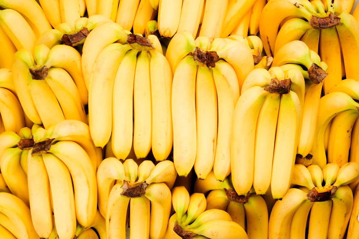 A stack of bananas at the grocery store.