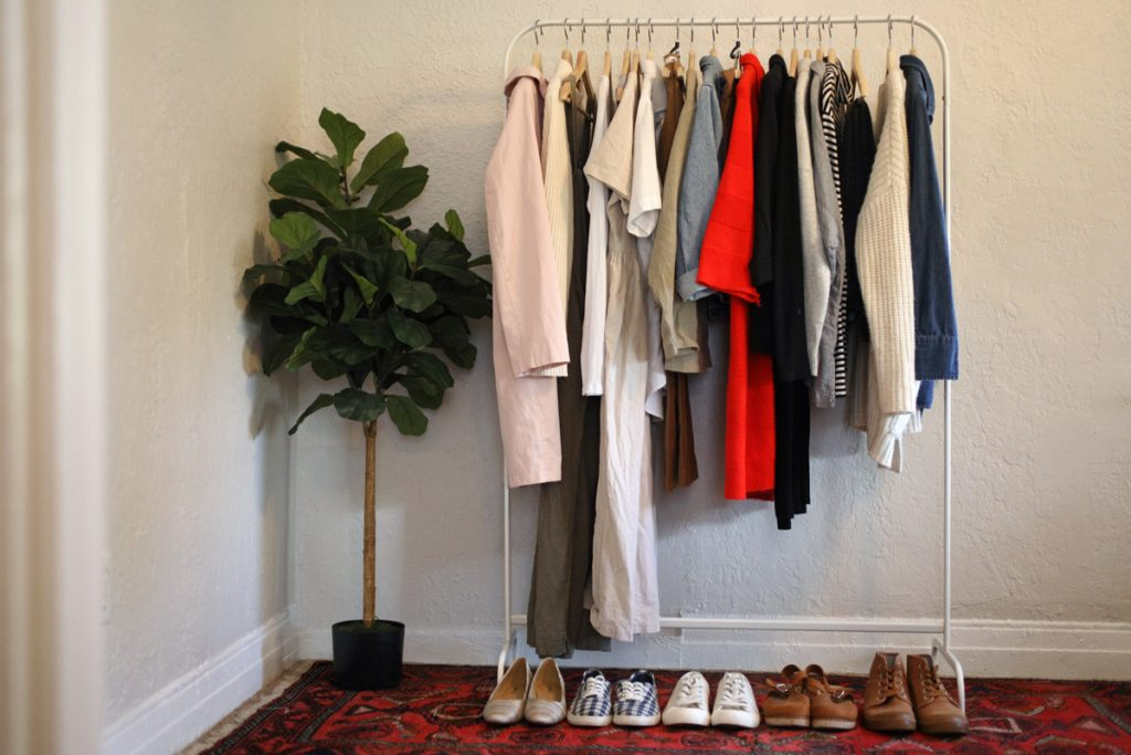 Clothes are hung up on a rack.